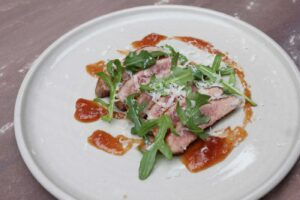Secreto Iberico with Quince, Rocket and Manchego Cheese