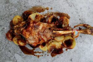Roasted Leg of Milk-Fed Lamb with Black Olives and Anchovies