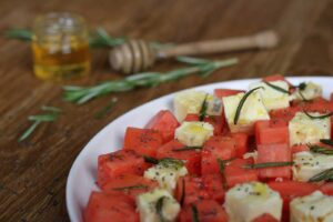 Watermelon and Goats Cheese Salad with Honey and Rosemary Oil