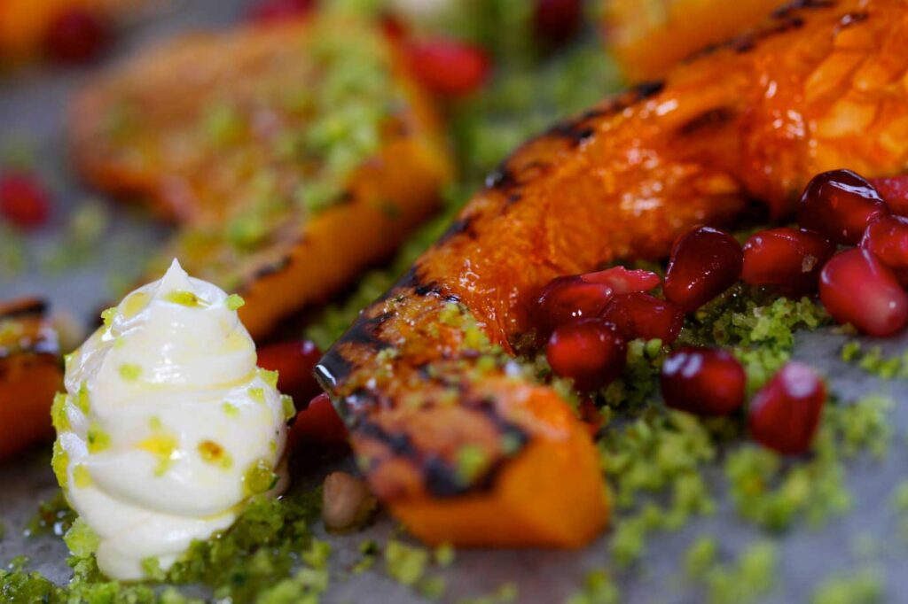 Chargrilled Butternut Squash with Goats Cheese Cream, Pomegranate and Pistachio Migas